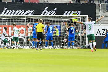 Ingolstadt's Nico Antonitsch heads the ball into his own net.