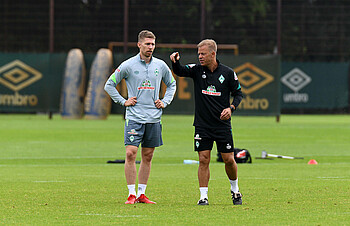 Markus Anfang and Mitchell Weiser on the SVW training pitch.